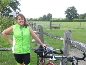 Pam on bike yellow